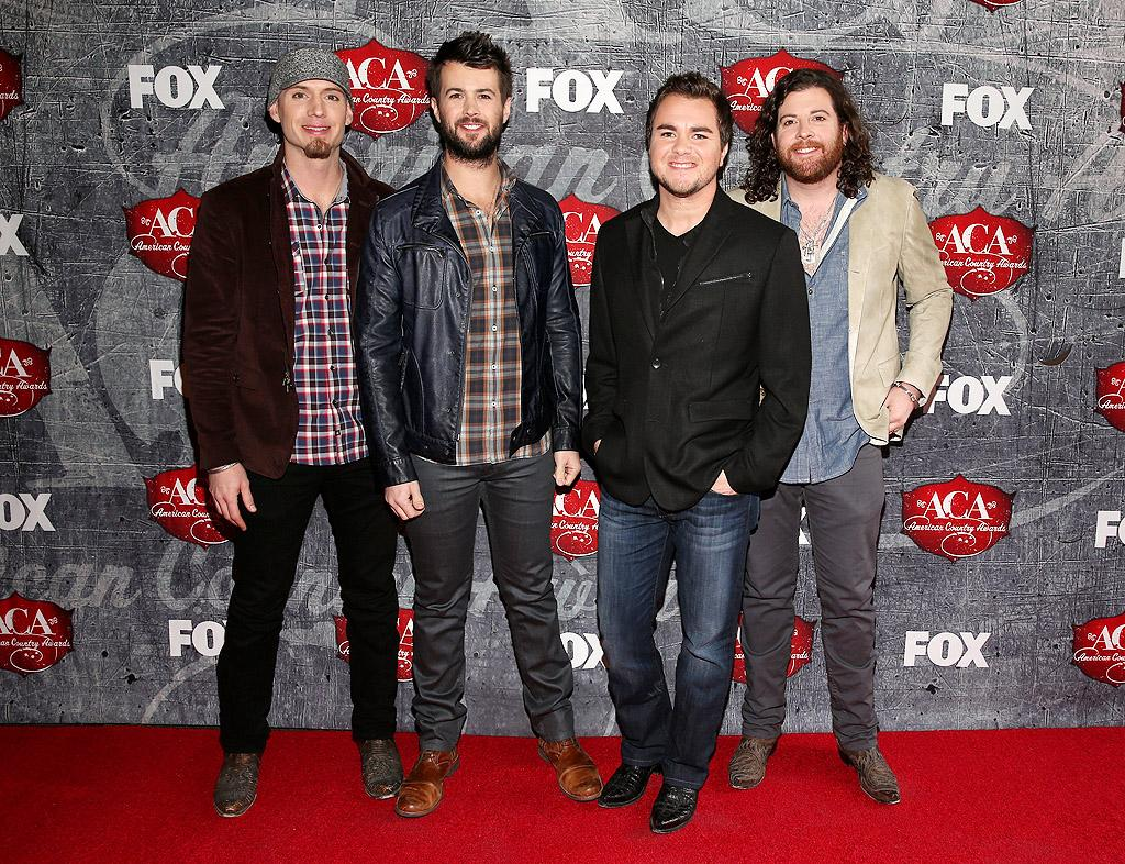 LAS VEGAS, NV - DECEMBER 10:  (L-R) Bassist Jon Jones, drummer Chris Thompson, frontman Mike Eli and guitarist James Young of the Eli Young Band arrive at the 2012 American Country Awards at the Mandalay Bay Events Center on December 10, 2012 in Las Vegas, Nevada.  (Photo by Christopher Polk/ACA2012/Getty Images)