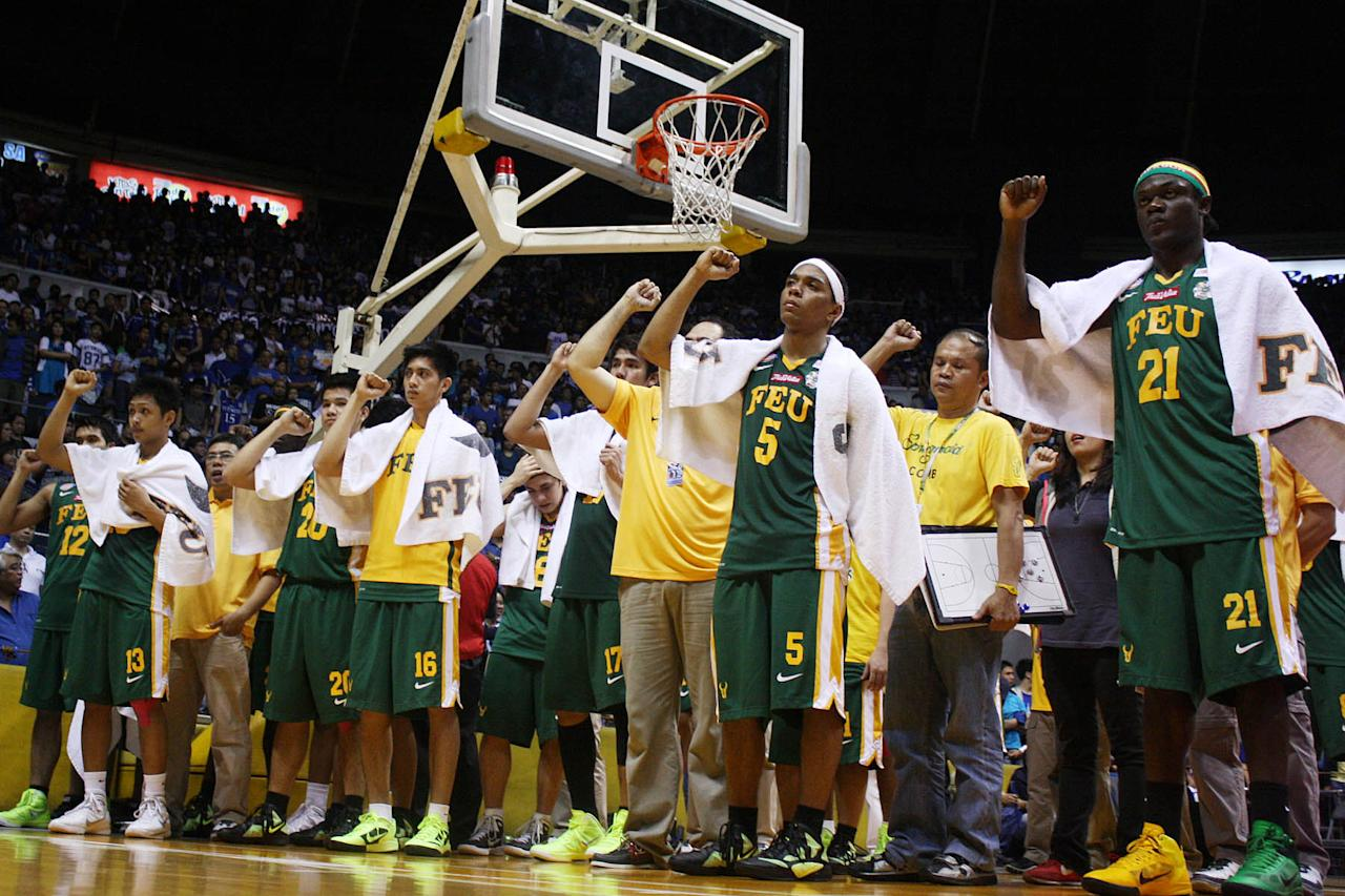 FEU Tamaraws players with their coach Bert Flores seen after the game 2 of 74th Season of the UAAP men's basketball championship series held at Smart Araneta Coliseum in Quezon City. The Tamaraws placed as first runner up of this year's season of UAAP. (Marlo Cueto/NPPA Images)