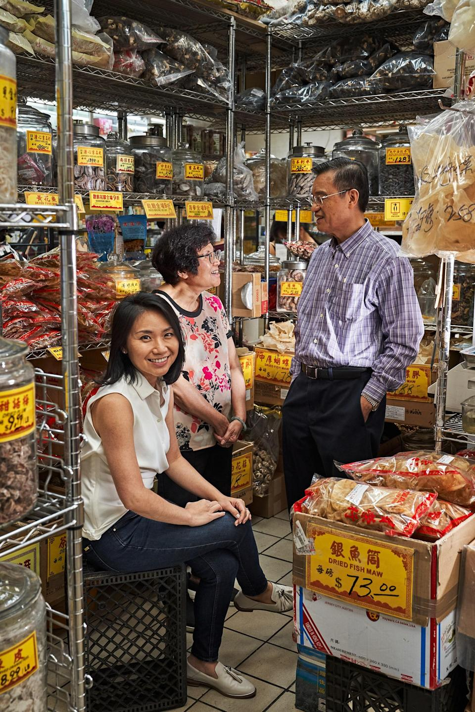 """To re-create the flavors of Chinatown in your own kitchen, hit <a href=""""https://powing.com/"""" rel=""""nofollow noopener"""" target=""""_blank"""" data-ylk=""""slk:Po Wing Hong"""" class=""""link rapid-noclick-resp""""><strong>Po Wing Hong</strong></a><strong>,</strong> whose ruby-red awning—and the shopping attendant who diligently parks customers' rolling carts outside—makes visits feel like a trip to the theater. Inside, the space opens up to reveal long aisles stocked with everything from bottled sauces and bagged noodles to purplish dried sausages and slick jellyfish slices. (You can also pick up dried goods like plums and sea cucumbers, sold by weight.) <a href=""""https://www.aquabestnyc.com/"""" rel=""""nofollow noopener"""" target=""""_blank"""" data-ylk=""""slk:Aqua Best"""" class=""""link rapid-noclick-resp""""><strong>Aqua Best</strong></a><strong>,</strong> on Grand, sells glistening fluke, branzino, and sea bass, all propped up on ice. If your day starts early, swing by the fruit stands flanking both sides of Mulberry Street near the intersection of Grand: Vendors hawk fresh oranges and just- ripe cherries, prickly dragon fruit, and unwieldy durian beneath multicolored beach umbrellas."""