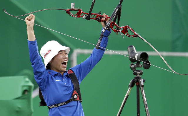 <p>Taiwan's Tan Ya-ting celebrates after winning the bronze medal match at the women's team archery competition at the Sambadrome venue during the 2016 Summer Olympics in Rio de Janeiro, Brazil, Sunday, Aug. 7, 2016. (AP Photo/Natacha Pisarenko) </p>