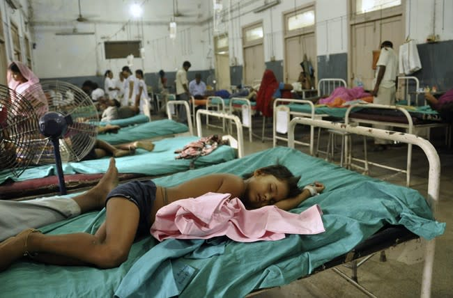 Indian children who fell sick after eating a free school lunch lie at a hospital in Patna, India, Wednesday, July 17, 2013. At least 22 children died and more than two dozen others were sick after eating a free school lunch that was tainted with insecticide, Indian officials said Wednesday. (AP Photo/Aftab Alam Siddiqui)
