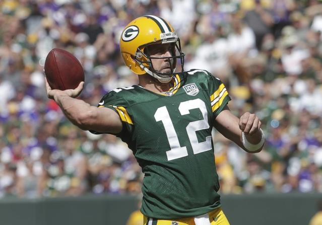 Aaron Rodgers, a primary beneficiary of the NFL's stringent roughing the passer rules, is not a fan of them. (AP)