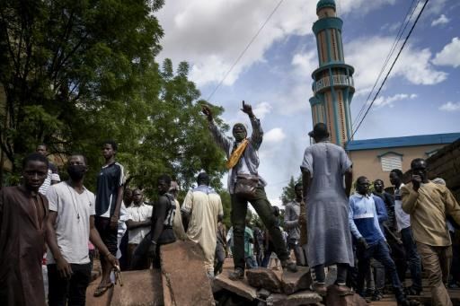 Protesters at a barricade erected in front of the Salam Mosque in Bamako