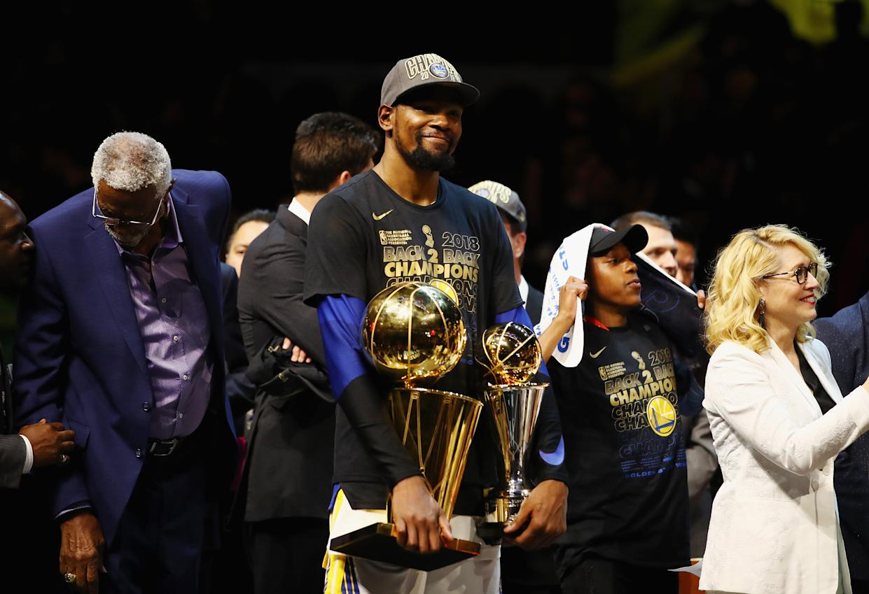 CLEVELAND, OH - JUNE 08:  Kevin Durant #35 of the Golden State Warriors celebrates with the Larry O'Brien Trophy and MVP Trophy after defeating the Cleveland Cavaliers during Game Four of the 2018 NBA Finals at Quicken Loans Arena on June 8, 2018 in Cleveland, Ohio. The Warriors defeated the Cavaliers 108-85 to win the 2018 NBA Finals.  NOTE TO USER: User expressly acknowledges and agrees that, by downloading and or using this photograph, User is consenting to the terms and conditions of the Getty Images License Agreement.  (Photo by Gregory Shamus/Getty Images)