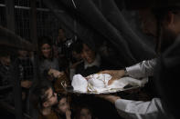 """Ultra-Orthodox Jewish women are holding 30-day-old Yossef Tabersky, the great grandchild of the chief rabbi of the Lelov Hassidic dynasty, during the """"Pidyon Haben"""" ceremony in Beit Shemesh, Israel, Thursday, Sept. 16, 2021. The Pidyon Haben, or redemption of the firstborn son, is a Jewish ceremony hearkening back to the biblical exodus from Egypt. (AP Photo/Oded Balilty)"""