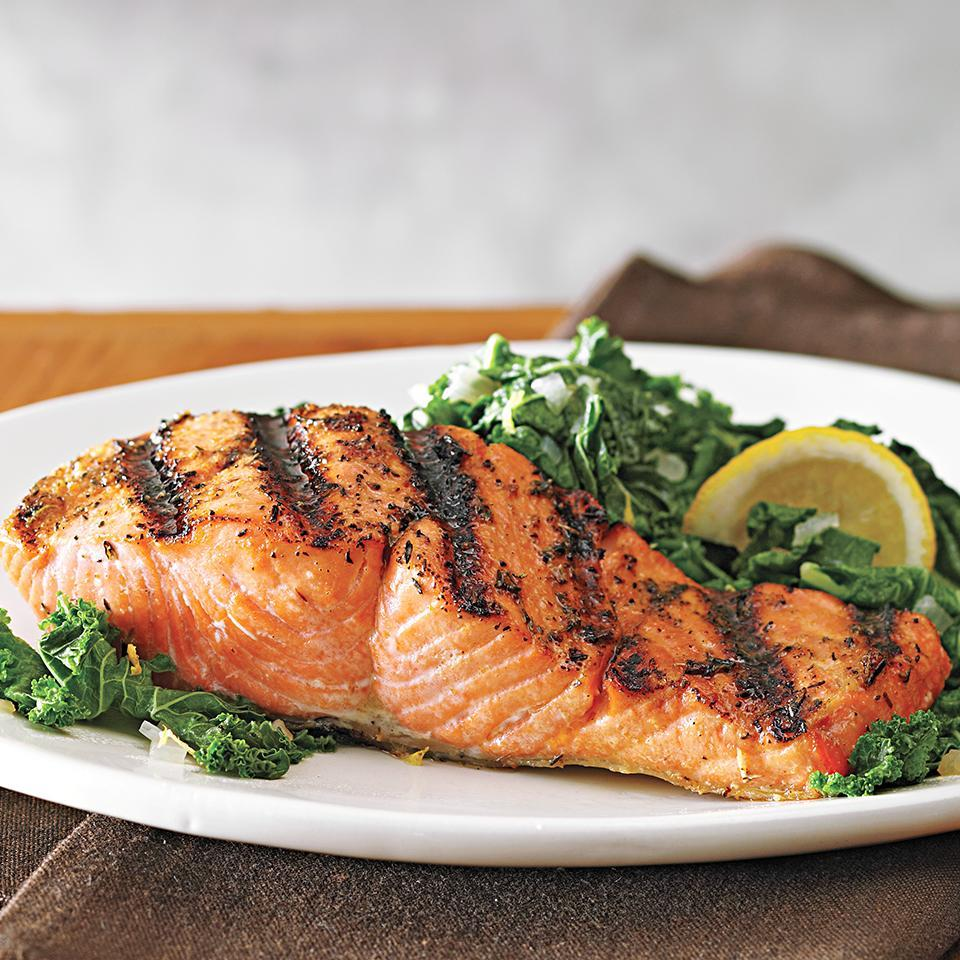 <p>In this healthy dinner recipe, salmon fillets are seasoned with a zesty dry rub, grilled and served with a simple side--lemon-seasoned sautéed kale and shallots. Sometimes simple is best!</p>