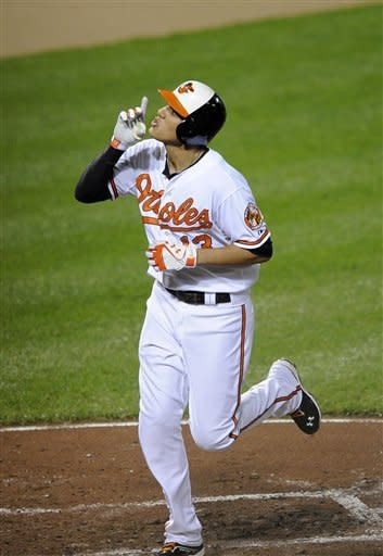Baltimore Orioles' Manny Machado celebrates his home run during the fifth inning of a baseball game against the Toronto Blue Jays, Wednesday, Sept. 26, 2012, in Baltimore. The Orioles won 12-2. (AP Photo/Nick Wass)