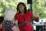 Democratic gubernatorial candidate, former Del. Jennifer Carroll Foy, right, talks with a greets supporter during a rally in Hampton, Va., Tuesday, June 1, 2021. Carroll Foy faces four other Democrats in the primary June 8. (AP Photo/Steve Helber)