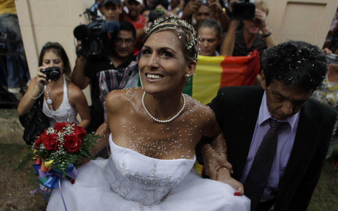Transsexual Wendy Iriepa arrives for her wedding with best man Reinaldo Escobar in Havana, Cuba, Saturday Aug. 13, 2011. Iriepa, whose sex change operation was paid for by the state, tied the knot with Ignacio Estrada in a first-of-its-kind wedding for Cuba. Gay marriage is not legal in Cuba and Saturday's wedding does nothing to change that since Iriepa is legally considered a woman. (AP Photo/Javier Galeano)