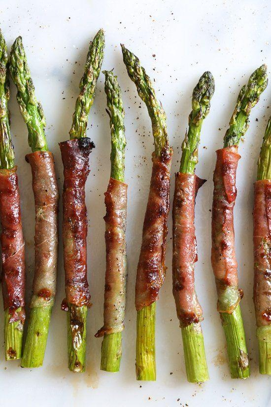 """<p>These three-ingredient spears are elegant, delicious, and a great low-carb way to round out your Thanksgiving plate.</p><p><strong>Get the recipe at <a href=""""https://www.skinnytaste.com/grilled-prosciutto-wrapped-asparagus/"""" rel=""""nofollow noopener"""" target=""""_blank"""" data-ylk=""""slk:SkinnyTaste"""" class=""""link rapid-noclick-resp"""">SkinnyTaste</a>.</strong></p><p><strong><a class=""""link rapid-noclick-resp"""" href=""""https://www.amazon.com/Lodge-Square-Pre-seasoned-Draining-Grilling/dp/B0000CF66W/?tag=syn-yahoo-20&ascsubtag=%5Bartid%7C10050.g.33501494%5Bsrc%7Cyahoo-us"""" rel=""""nofollow noopener"""" target=""""_blank"""" data-ylk=""""slk:SHOP GRILL PANS"""">SHOP GRILL PANS</a><br></strong></p>"""
