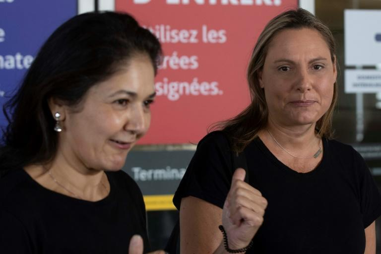 Vina Nadjibulla (L) and Ariana Botha, the wife and sister of Michael Kovrig, speak to the media outside the Toronto airport before his arrival (AFP/Lars Hagberg)