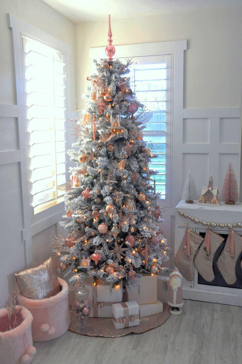 """<p>Whether you recently welcomed a baby girl or you just really love blush pink, you're going to want to bring this tree to life this holiday season. </p><p><strong><em>Get the tutorial at <a href=""""https://karaspartyideas.com/2016/11/blush-pink-vintage-christmas-tree.html"""" rel=""""nofollow noopener"""" target=""""_blank"""" data-ylk=""""slk:Kara's Party Ideas"""" class=""""link rapid-noclick-resp"""">Kara's Party Ideas</a>.</em></strong></p><p><a class=""""link rapid-noclick-resp"""" href=""""https://www.amazon.com/Christmas-Ornaments-Plastic-Shatterproof-Decoration/dp/B08DY1PNPT/?tag=syn-yahoo-20&ascsubtag=%5Bartid%7C10070.g.2025%5Bsrc%7Cyahoo-us"""" rel=""""nofollow noopener"""" target=""""_blank"""" data-ylk=""""slk:BUY PINK ORNAMENTS"""">BUY PINK ORNAMENTS</a><br></p>"""