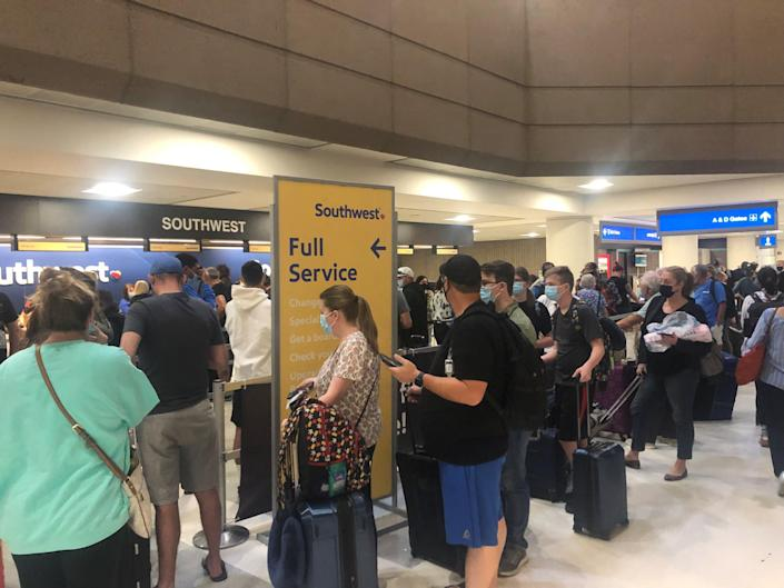 The Southwest Airlines rebooking line at Phoenix Sky Harbor International Airport on Sunday, Oct. 10. Southwest Airlines has canceled more than 1,000 Sunday flights across the country  after canceling 800 on Saturday.
