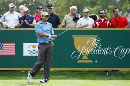 International Team player Jason Day of Australia reacts after his tee shot on the 12th hole during the second practice round for the 2013 Presidents Cup golf tournament at Muirfield Village Golf Club in Dublin, Ohio