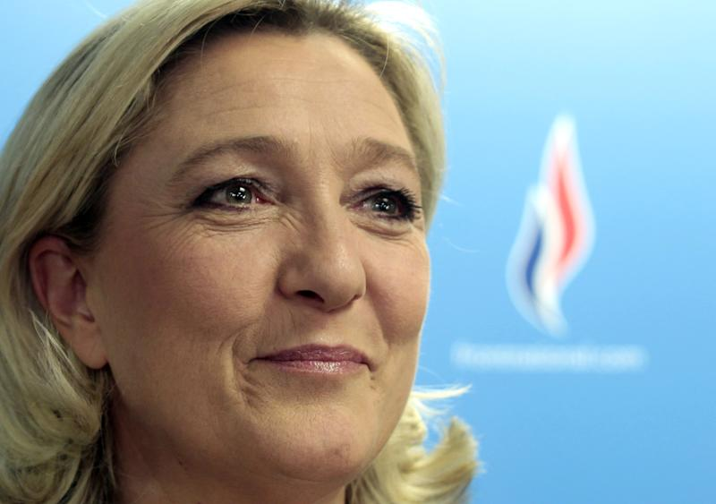 FILE - In this March 30, 2014 file photo, France's far right National Front leader Marine Le Pen attends a party meeting in Nanterre, west of Paris. The extreme right is rising across Europe and Le Pen wants to seize the momentum, raise the voice of her anti-immigration National Front in one of the European Union's crucial institutions and amplify it through alliances. (AP Photo/Jacques Brinon, File)