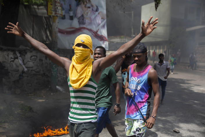 People protest against the assassination of Haitian President Jovenel Moïse near the police station of Petion Ville in Port-au-Prince, Haiti, Thursday, July 8, 2021. Officials pledged to find all those responsible for the pre-dawn raid on Moïse's home early Wednesday in which the president was shot to death and his wife, Martine, critically wounded. (AP Photo/Joseph Odelyn)