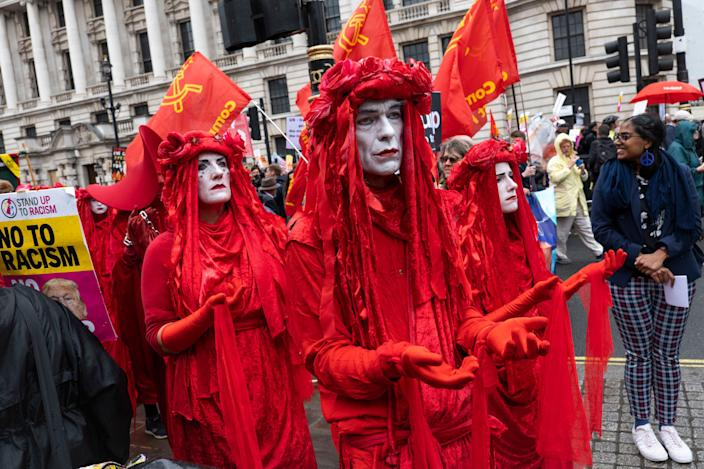 Mime artists dressed in red with white face paint during a demonstration against U.S. President Donald Trump's state visit to the U.K. (Photo: Sam Mellish / In Pictures via Getty Images)