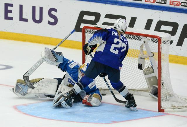 Annie Pankowski of the United States scores a shootout goal past goalkeeper Noora R'ty of Finland during the IIHF Women's Ice Hockey World Championships final match between the United States and Finland in Espoo, Finland, on Sunday, April 14, 2019. (Mikko Stig/Lehtikuva via AP)