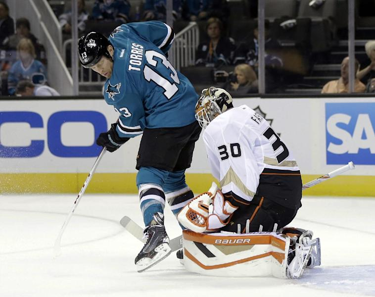 San Jose Sharks left wing Raffi Torres (13) has his shot deflected by Anaheim Ducks goalie Viktor Fasth (30), of Sweden, during the first period of a preseason NHL hockey game on Friday, Sept. 20, 2013, in San Jose, Calif. (AP Photo/Marcio Jose Sanchez)