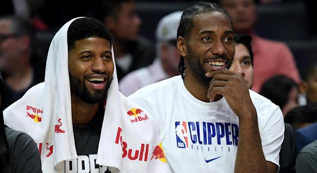 Paul George and Kawhi Leonard posted up at Drake's place to devise their NBA-altering plan. (Photo by Harry How/Getty Images)