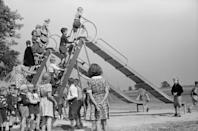 <p>Children taking turns on the slide at a school playground in Greenhills, Ohio. </p>