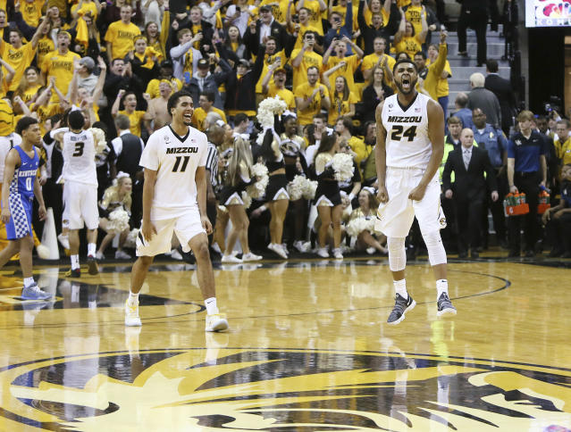 Missouri forwards Kevin Puryear (24) and Jontay Porter (11) celebrate after their team defeated Kentucky 69-60 in an NCAA college basketball game Saturday, Feb. 3, 2018, in Columbia, Mo. (Chris Lee/St. Louis Post-Dispatch via AP)