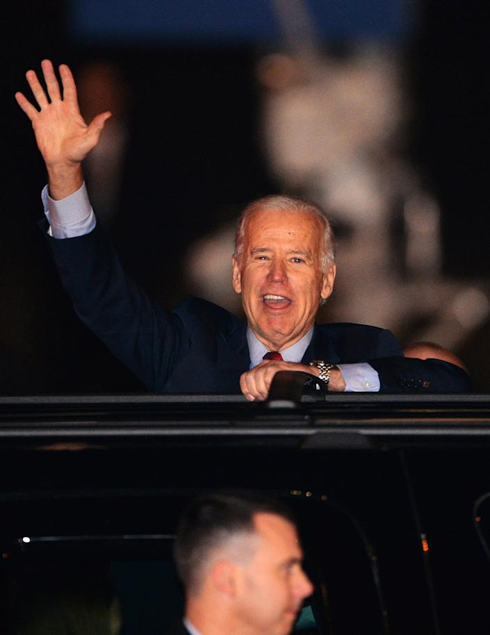 US Vice President Joe Biden waves upon his arrival at the Tokyo International Airport on December 1, 2013 on the first leg of his Asian tour. Biden will meet with Japanese leaders, with Tokyo hoping for some fulsome backing in its vicious territorial spat with China.