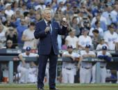 <p>Vin Scully helps throw out the ceremonial first pitch before Game 2 of baseball's World Series between the Houston Astros and the Los Angeles Dodgers Wednesday, Oct. 25, 2017, in Los Angeles. (AP Photo/David J. Phillip) </p>
