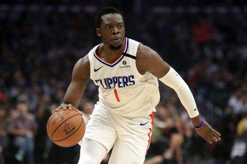 Reggie Jackson of the LA Clippers dribbles upcourt during the first half of a game against the Memphis Grizzlies at Staples Center on February 24, 2020 in Los Angeles, California.