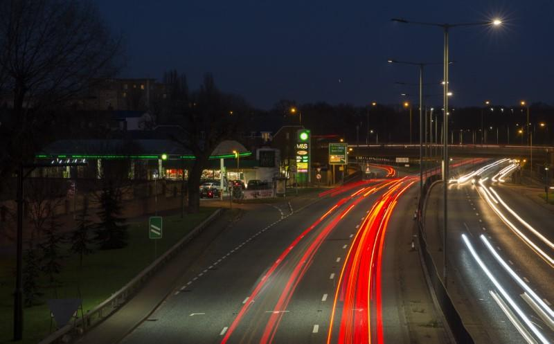 Traffic passes a BP garage selling fuel on the north circular road in London, Britain
