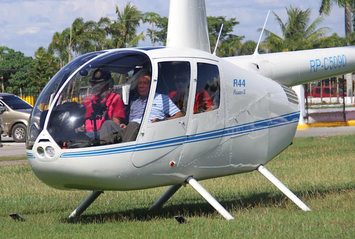 Then-local mayor of Davao city Rodrigo Duterte (R), aboard a helicopter, arrives at the provincial capitol in Tagum city, Davao del Norte, southern Philippines for the Regional Peace and Order Council meeting, April 20, 2015. Picture taken April 20, 2015. REUTERS/Lean Daval Jr.