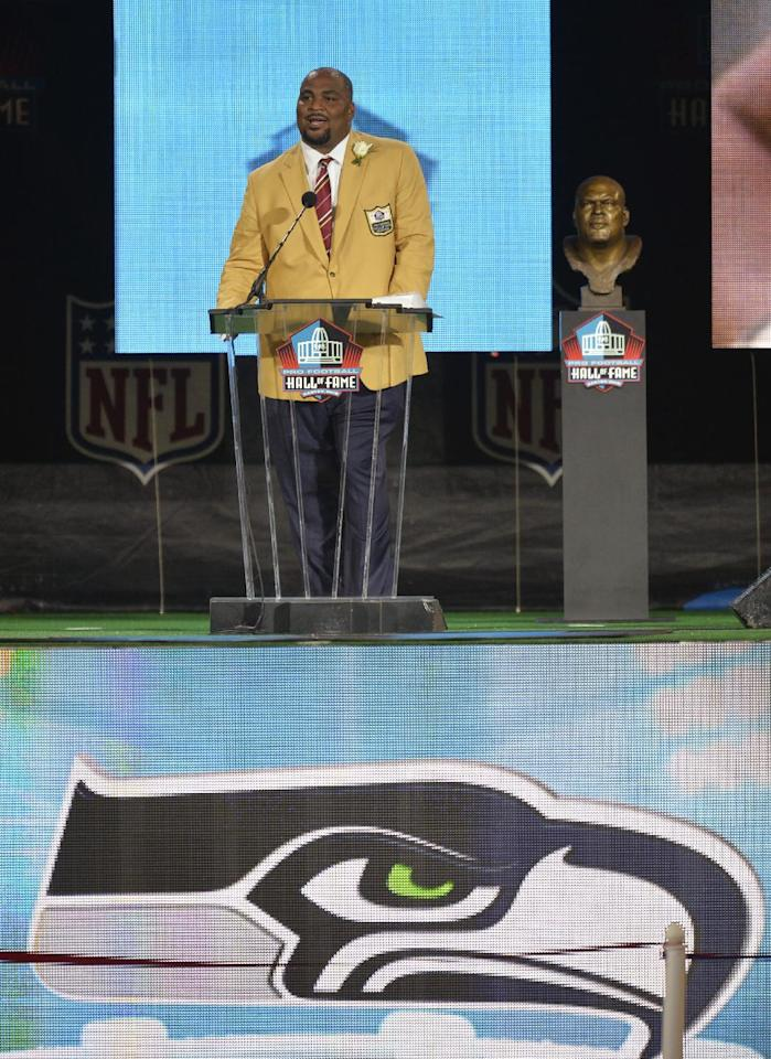 Hall of Fame inductee Walter Jones speaks during the Pro Football Hall of Fame enshrinement ceremony Saturday, Aug. 2, 2014, in Canton, Ohio. (AP Photo/David Richard)