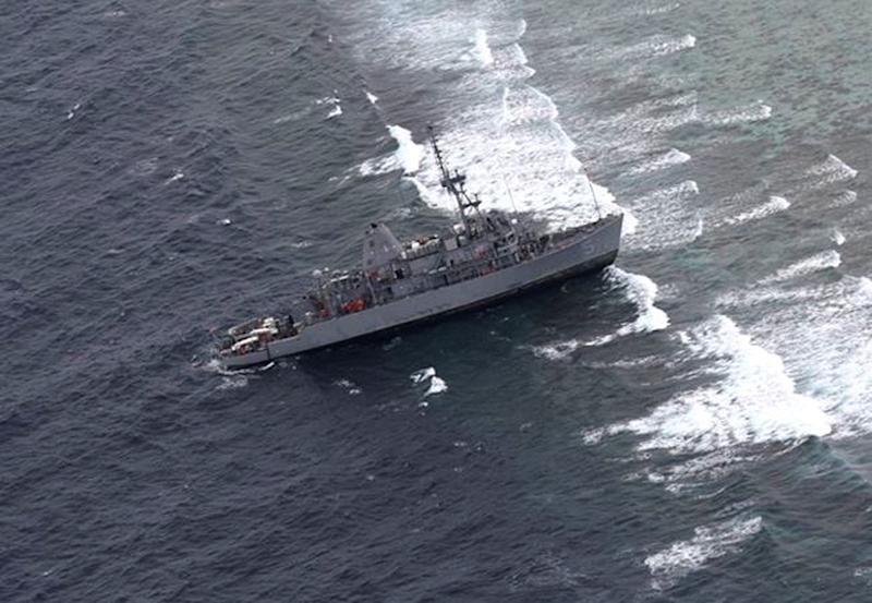 This Jan. 17, 2013 photo released by the Armed Forces of the Philippines Western Command (WESCOM) shows the USS Guardian, a US Navy minesweeper, after running aground off Tubbataha Reef, a World Heritage Site in the Sulu Sea, 640 kilometers (400 miles) southwest of Manila, Philippines. Officials said no injuries were reported to the crew and Philippine authorities were trying to determine if the ship caused damaged to a marine park in a protected area. (AP Photo/AFP WESCOM) EDITORIAL USE ONLY, NO SALES