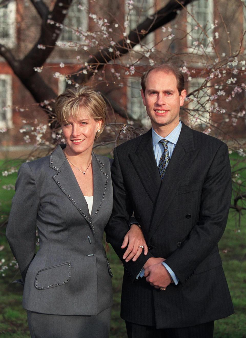 <p>Prince Edward met Sophie Rhys-Jones back in 1993 at a tennis event.<br><br>They became engaged on 6 January 1999 after the young royal proposed with a two-carat oval ring which features two heart-shaped gemstones.<br><br>The ring was made by Asprey and Garrard and reportedly cost £105,000 at the time. <em>[Photo: Getty]</em> </p>