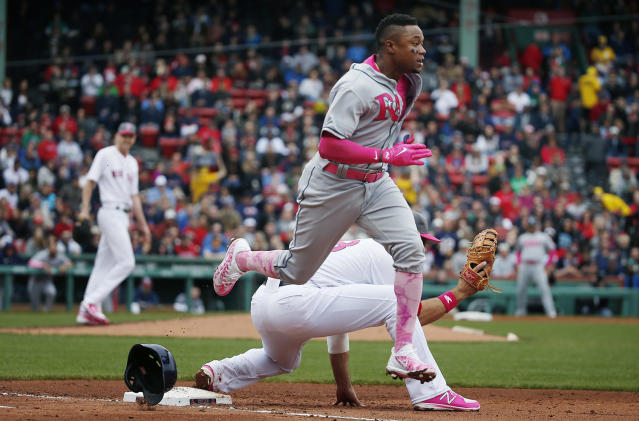 <p>Tampa Bay Rays' Tim Beckham, center, can not beat the throw to Boston Red Sox's Mitch Moreland, behind, on a ground out in the fifth inning of a baseball game, May 13, 2017, in Boston. (Photo: Michael Dwyer/AP) </p>
