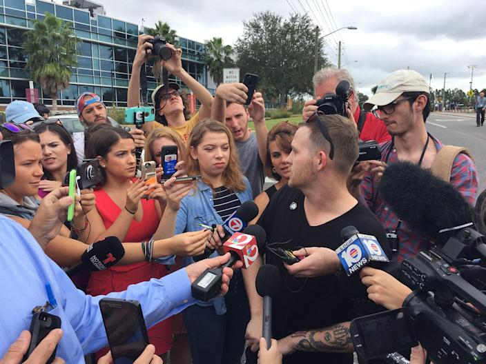 <p>October 19, 2017 – Gainesville, FL, USA – Sam Hyde of Houston, Texas, who is wearing a Nazi SS pin on his shirt, talks to the media prior to scheduled speech by white nationalist Richard Spencer at the University of Florida Thursday, Oct. 19, 2017 in Gainesville, Fla. (Photo: Ricardo Ramirez-Buxeda/TNS via ZUMA Wire) </p>