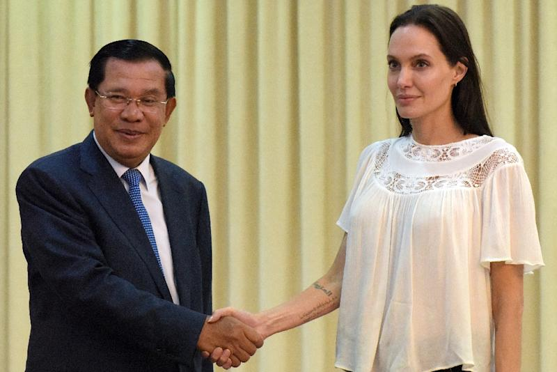 US actress Angelina Jolie (R) shakes hands with Cambodian Prime Minister Hun Sen during a meeting at the Peace Palace in Phnom Penh on September 17, 2015