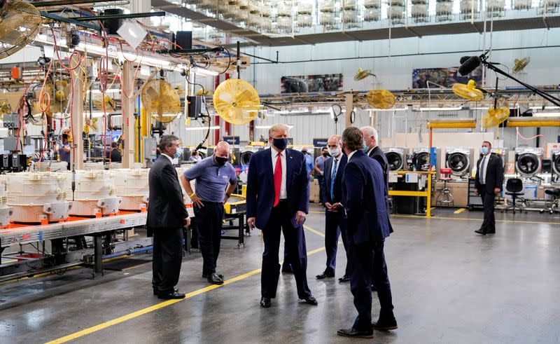 FILE PHOTO: U.S. President Donald Trump tours Whirlpool Corporation washing machine factory in Clyde, Ohio
