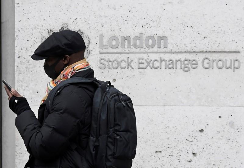 FTSE 100 rises after BoE's new rescue measures, midcaps stuck in the red
