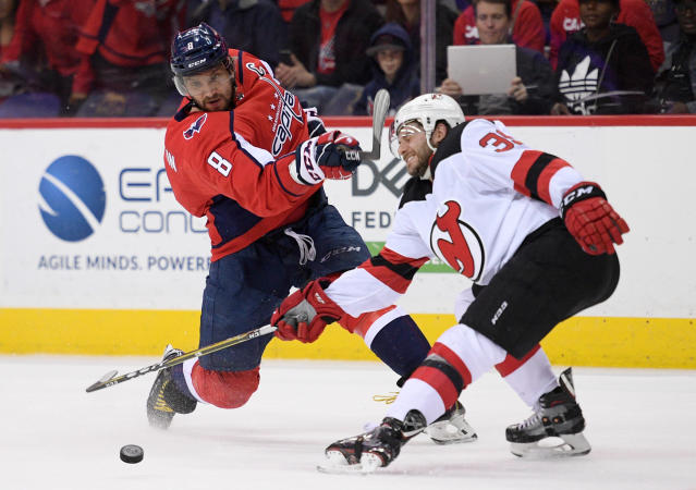 Washington Capitals left wing Alex Ovechkin (8), of Russia, shoots against New Jersey Devils left wing Brian Gibbons (39) during the third period of an NHL hockey game Saturday, April 7, 2018, in Washington. The Capitals won 5-3. (AP Photo/Nick Wass)