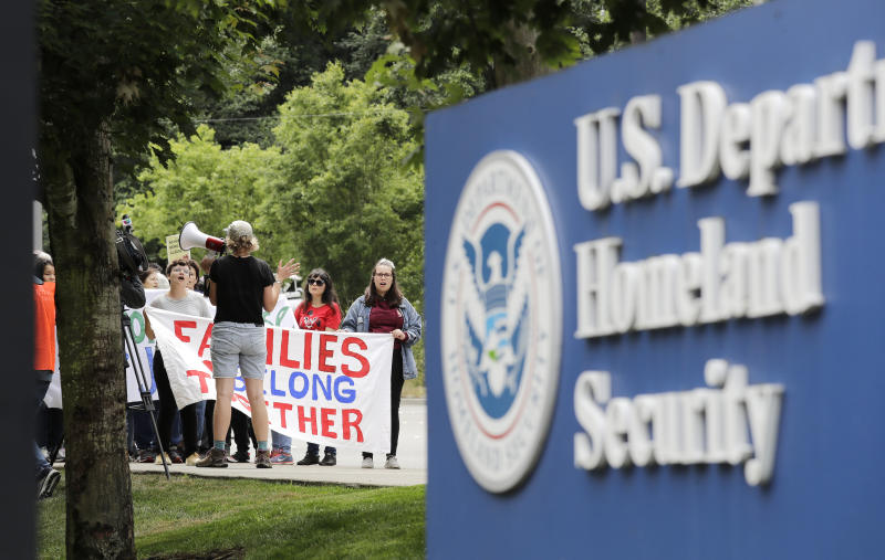 In this photo taken Wednesday, July 17, 2019, supporters of Jose Robles gather before he turned himself in to immigration authorities in Tukwila, Wash. The prospect of nationwide immigration raids has provided evidence that legions of pastors, rabbis and their congregations stand ready to help vulnerable immigrants with offers of sanctuary and other services. (AP Photo/Elaine Thompson)