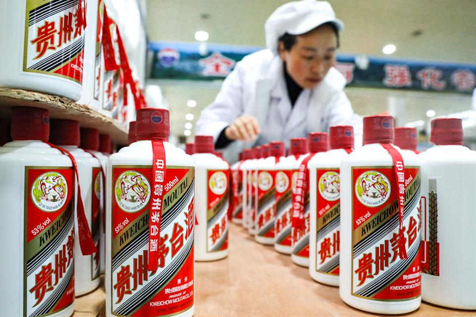 GUIZHOU, Nov. 27, 2020 -- A worker conducts packaging works at a distillery in Maotai town of Renhuai, southwest China's Guizhou Province, Nov. 27, 2020.   Maotai is a small town in Renhuai City in mountainous Guizhou. What distinguishes it from other towns is that it produces a famous brand of Chinese liquor Moutai. The spirit, made from sorghum and wheat, takes up to one year for the whole production process, involving nine times of steaming, eight times of fermentation and seven times of distillation, before aged in clay pots. (Photo by Ou Dongqu/Xinhua via Getty) (Xinhua/Ou Dongqu via Getty Images)