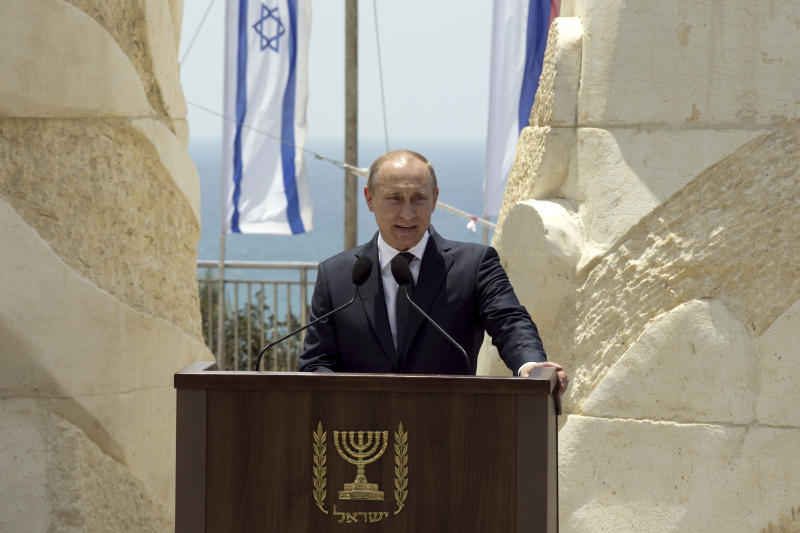 Russian President Vladimir Putin delivers a speech during an inauguration ceremony of a memorial to Red Army veterans of World War II in Netanya, Israel, Monday June 25, 2012. The West's standoff with Iran over its nuclear program was expected to top the agenda on Monday as Russian President Vladimir Putin began a 24-hour visit to Israel. (AP Photo/Jack Guez, Pool)