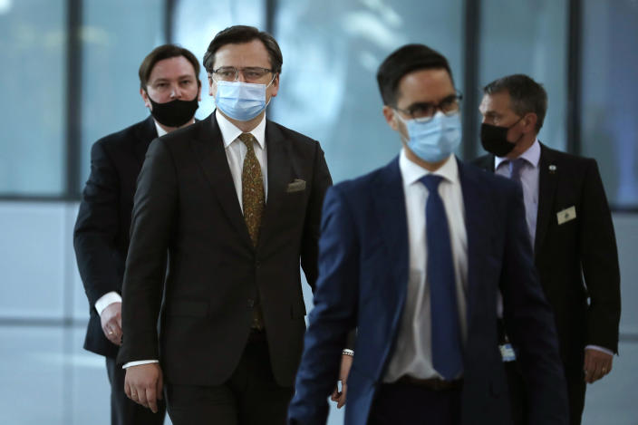 Ukraine's Foreign Minister Dmytro Kuleba, second left, arrives prior to a meeting with NATO Secretary General Jens Stoltenberg at NATO headquarters in Brussels, Tuesday, April 13, 2021. (AP Photo/Francisco Seco, Pool)