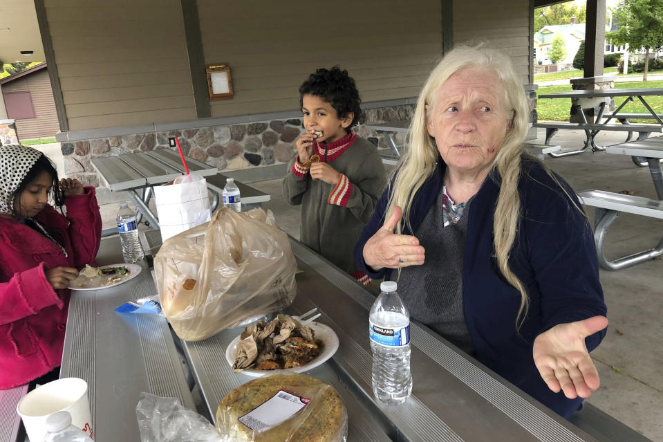 """Sherry Darwin of Oshkosh, Wis., talks about her support for President Donald Trump while picnicking with her grandson Donald in a park Tuesday, Sept. 29, 2020. """"I don't even believe it's true,"""" the 75-year-old retiree says of reports Trump paid little in income taxes in the years before becoming president.(AP Photo/Thomas Beaumont)"""