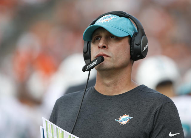 FILE - In this Oct. 7, 2018, file photo Miami Dolphins head coach Adam Gase stand on the sideline during the first half of an NFL football game against the Cincinnati Bengals in Cincinnati. Gase has been fired after three seasons as the Miami Dolphins coach, including a 7-9 finish this year. Gase confirmed his dismissal in a text message Monday, Dec. 31 to The Associated Press. (AP Photo/Gary Landers, File)