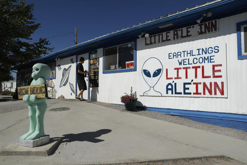 "A person walks into the Little A'Le'Inn, Sept. 18, 2019, in Rachel, Nev. No one knows what to expect, but lots of people are preparing for ""Storm Area 51"" in the Nevada desert. Neighbors, elected officials and experts say the craze sparked by an internet joke inviting people to """"see them aliens"" might become a cultural marker, a dud or something in-between. (Photo: John Locher/AP)"