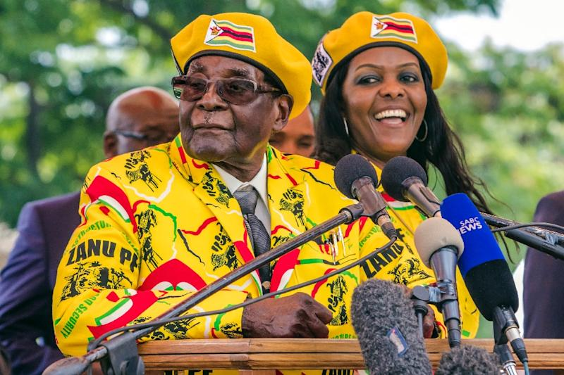 Robert Mugabe and his wife Grace, pictured at a rally on November 8 2017 -- one of their last appearances before his fall from power (AFP Photo/Jekesai NJIKIZANA)