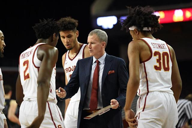 Andy Enfield talks to his players during USC's 88-81 loss to Washington. (Getty)