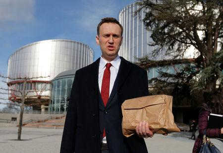 Russian opposition leader Navalny leaves the European court of Human Rights after a hearing regarding his case against Russia at the court in Strasbourg